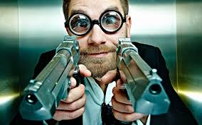 A guy with glasses and gun.jpg