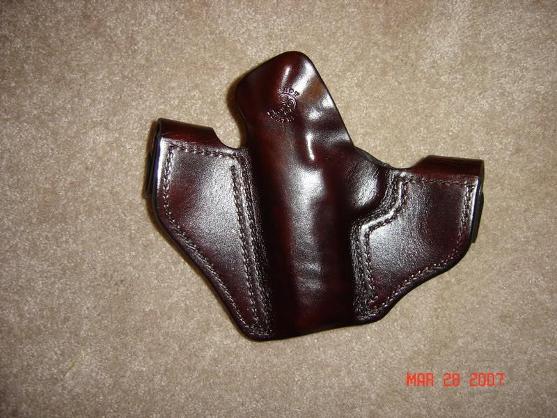 ai306.photobucket.com_albums_nn269_dustingaunder_Guns_20and_20Related_Handguns_holster008mm6.jpg