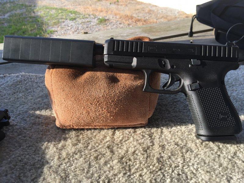 Suppressed Glock 44 -- 1.jpg